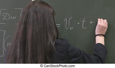 écolière, tableau noir, formule, écriture
