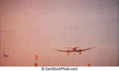 1958-vintage, 8mm, atterrissage avion