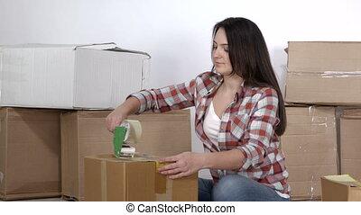 adhésif, femme, emballage, boîtes, en mouvement, distributeur, usages, carton, bande