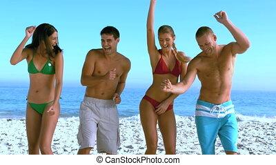 amis, groupe, danse, plage