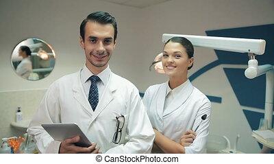 appareil photo, dentistes, regard, équipe