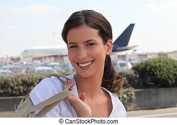arrivant, aéroport, femme