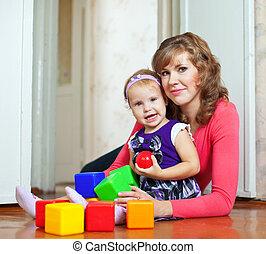 bébé bloque, heureux, jeux, mère