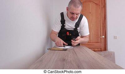 bande, meubles, ouvrier, utilisation, mesure