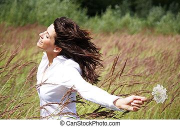 belle femme, elle, figure, fleur, dehors, vent