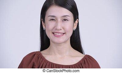 belle femme, figure, asiatique, sourire heureux