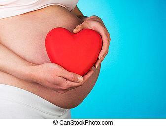 bleu, coeur, femme, pregnant, arrière-plan., tenue