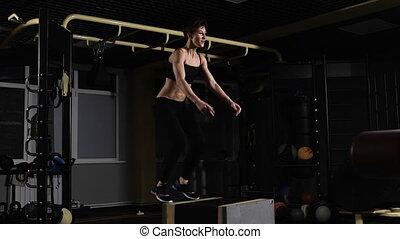 boîte, femme, athlète, -, jeune, foyer, saut, femme, gymnase