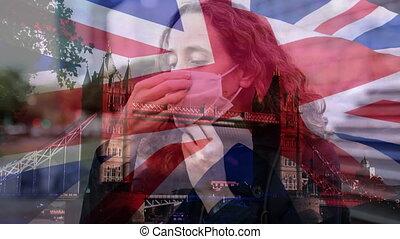 britannique, masque, femme, cityscape, porter, contre, onduler, sur, figure, drapeau