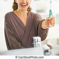 brosse dents, projection, femme, jeune, heureux