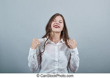 caucasien femme, garder, poings, gesture., gagnant, haut
