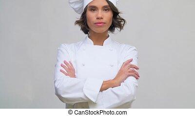 chef cuisinier femelle, toque, sourire