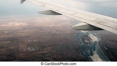 classement, vendange, voler, avion ligne, lakes., fenêtre., au-dessus, la terre, aile avion, vue