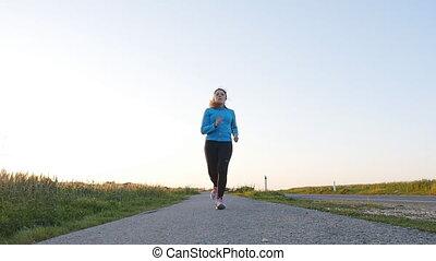 concept, road., coureur, jeune, courant, femme, fitness, levers de soleil