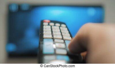 contrôle, équipe, fermé, fond, tv, channels., haut, brouillé, virage, surfer, style de vie, tenue, changer, intelligent, fin, main, éloigné, canal, homme