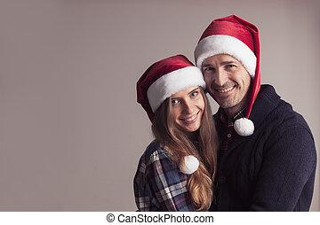 couple, heureux, chapeaux, santa