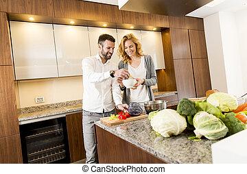 couple, jeune, cuisine