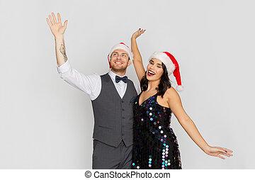 couple, noël, santa, chapeaux partie, heureux