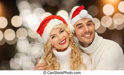 couple, sur, noël allume, santa, chapeaux, heureux