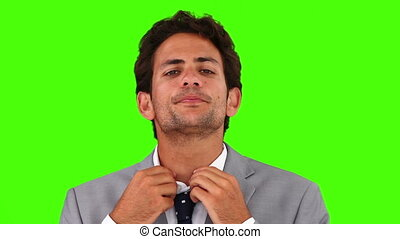 cravate, sien, mettre, homme affaires, jeune