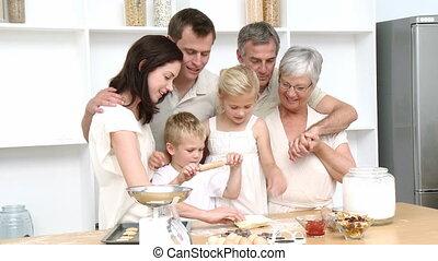 cuisson, famille heureuse, gâteaux