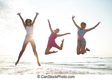 danse, plage, femelle sautante, amis, heureux
