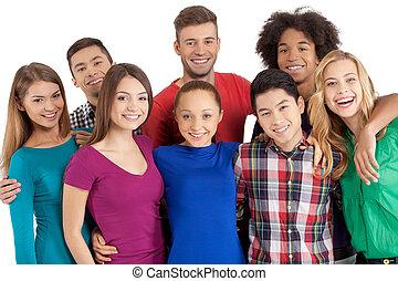 debout, nous, groupe, gens, appareil photo, isolé, jeune, gai, quoique, autre, multi-ethnique, chaque, fin, sourire, blanc, team!