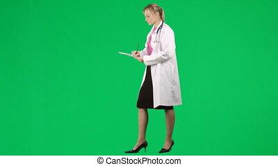 docteur féminin, rapport, écriture, patient