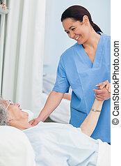 elle, main, quoique, tenue, infirmière, sourire, patient