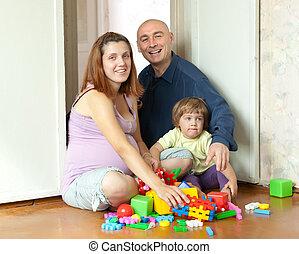famille heureuse, maison