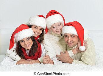 famille, heureux, santa, chapeaux