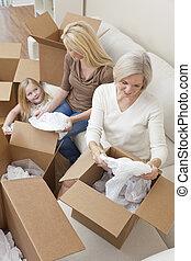 famille, maison, boîtes, en mouvement, femme, générations, déballage