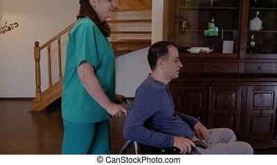 fauteuil roulant, jeune, aller, terrasse, infirmière, homme