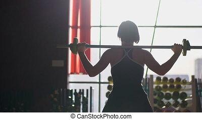 femme, barre, épaules., elle, lumière, gymnase, ascenseurs, fond