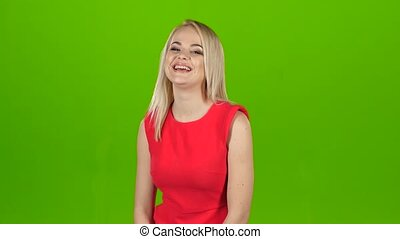 femme, contagieux, écran, sincerely, vert, laughs., blond, robe, rouges