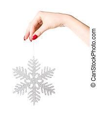 femme, grande main, tenue, vacances, flocon de neige