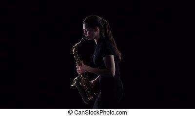 femme, jeux, motion., lent, saxophone, fond, studio, noir