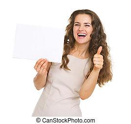 femme, projection, jeune, haut, papier, pouces, vide, sourire