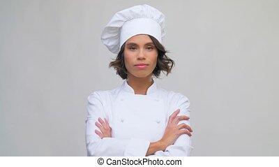 femme, sourire, chef cuistot, toque