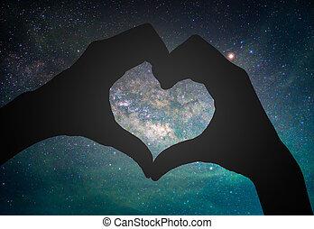 forme coeur, main, arrière-plan., silhouettes, manière, laiteux, galaxie