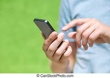 garçon, mur, écran, contre, téléphone, vert, doigt, tenue, toucher