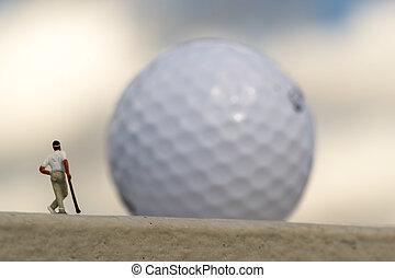 golfeur, miniature, géant, golfball, brouillé