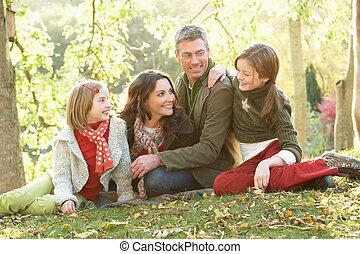 groupe, famille, délassant, automne, dehors, paysage