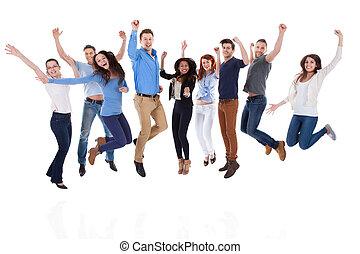 groupe, gens, bras, sauter, divers, élévation