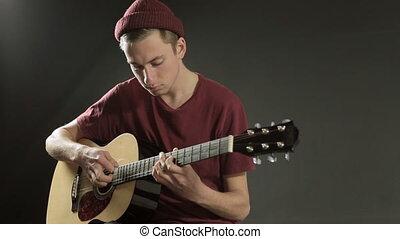guitare, musicien, jeune, sombre, studio, jouer