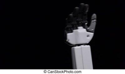 haut, robot, onduler, arrière-plan noir, fin, main, bonjour