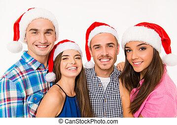 heureux, gens, jeune, chapeaux, santa, portrait