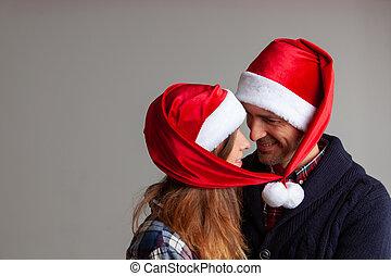 heureux, santa, couple, chapeaux
