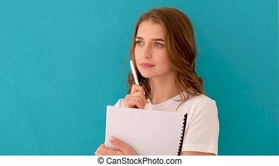 intelligent, étudiant, considérer, songeur, bloc-notes