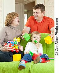 jeux, famille heureuse, maison